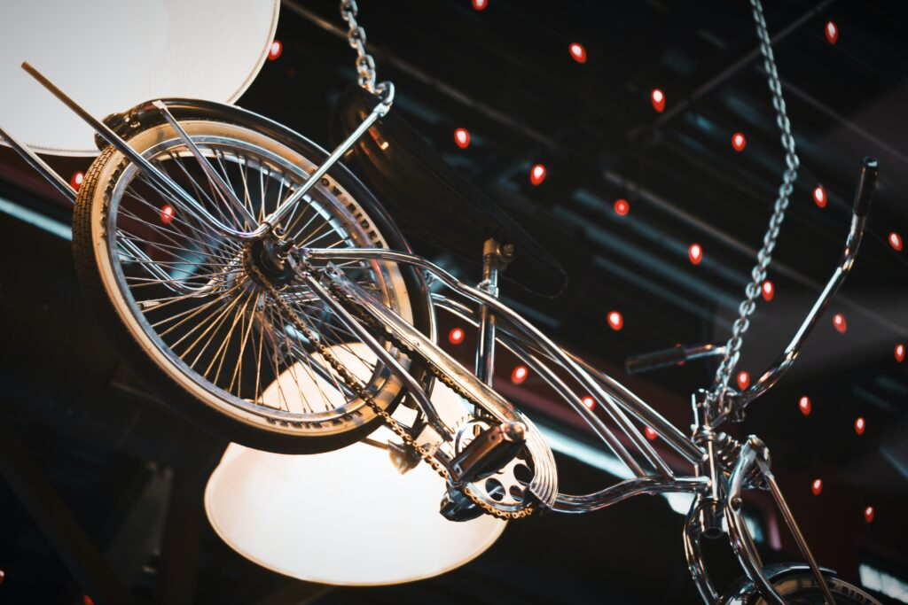 Bicycle wheels suspended mid-air in artistic light display