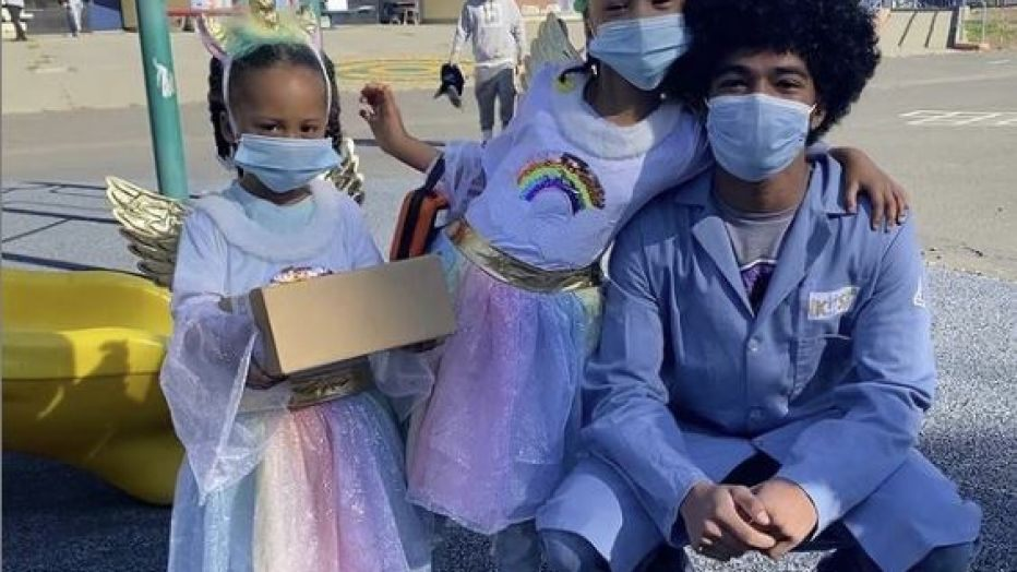 Group of children wearing masks outdoors
