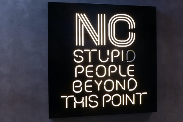 No stupid people beyond this point. A sign in front of a burger restaurant in Dubai