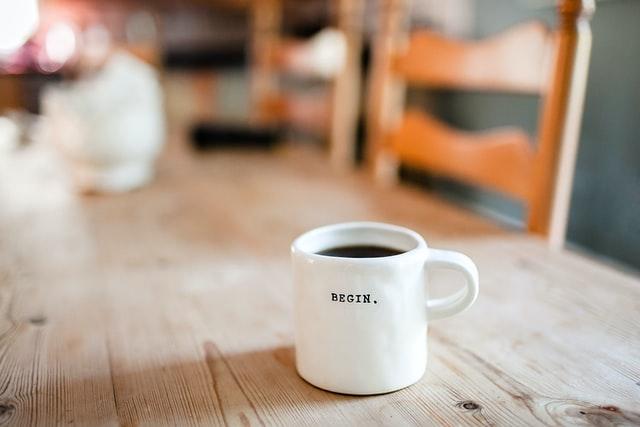 The word Begin on a coffee mug